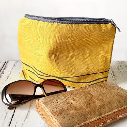Mustard clutch bag with wave design